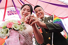 Same-sex couples wed in Taiwan mass military ceremony for 1st time