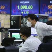 Asian markets step back from stimulus-driven record highs