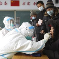 Beijing mulls anal swabs as COVID cases surge