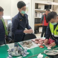 Taiwan sanitation worker finds red envelope containing NT$284,000 in recycled clothing