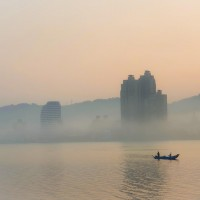 Photo of the Day: Lone fisherman on smoggy river in Taipei