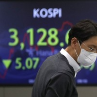 Asian stocks step back from record highs on rising bond yields, weak US data