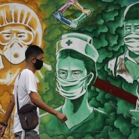 8 Taiwan van passengers sat maskless with COVID-positive Filipino
