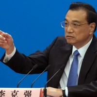 Chinese premier vows to push for 'peaceful unification' with Taiwan
