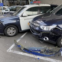Driver rams 2 cars, 13 scooters at Taipei police station
