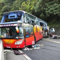 Passenger says Taiwan tour bus driver was speeding to catch up with convoy