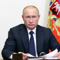 Putin signs law that could keep him in Kremlin until 2036