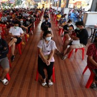 Thailand to close schools, bars after surge in COVID-19 cases
