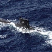 Search for missing Indonesian submarine enters second day as neighbors offer help