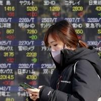 Asian stocks subdued amid holiday lull; Taiwan shares fall 2%