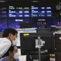 Asia shares flat, holidays help blunt US tech retreat