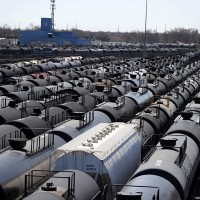 Oil prices climb as China, U.S. economic data lift markets