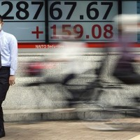 Asian shares spooked by US inflation alarm, yield jump