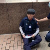 Unmasked man attacks police with machete near Taipei Railway Station