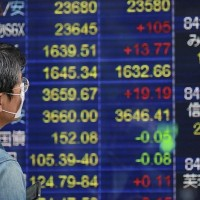 Asia shares cautious ahead of U.S. inflation test, Bitcoin slides