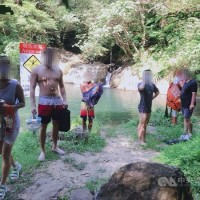 7 fined for taking off masks at New Taipei waterfall