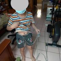 Taiwanese man chains son to elliptical