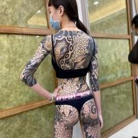 Taiwanese woman pursues full-body tattoo dream despite pandemic interruption