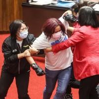 KMT 'valkyrie' wears motorcycle gloves to brawl in Taiwan's legislature