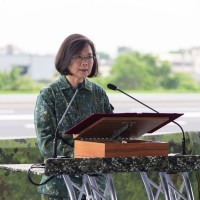 Taiwan president warns China against playing with fire