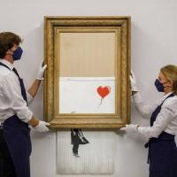 拍賣會自毀成碎紙 班克西畫作 《垃圾桶裡的愛》拍出新天價