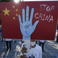 In parting shot, Trump administration accuses China of 'genocide' against Uighurs