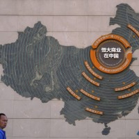 Beijing's silence on impending Evergrande collapse has analysts split over next move