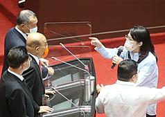 Taiwan premier calls legislator 'shameless' after 'first to surrender' accusation