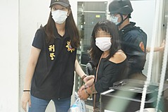Woman suspected of starting Kaohsiung building fire tied to petrol bombing