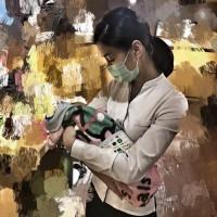 Angelic undertaker posts photo of newborn at mother's wake