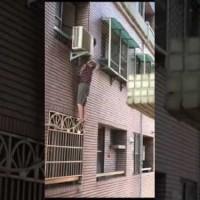 Elderly woman dangles from 11th floor after mistaking window for door