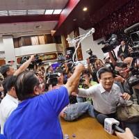 Intern studying in China throws water balloons at Taiwan legislators