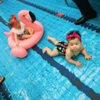 Photo of the Day: Babies 'swim' in mock Universiade pool on Taipei MRT