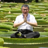 Photo of the day: Mayor Ko sits in lotus position on giant lotus