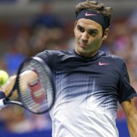 Federer wins in 3 sets to reach US Open quarters