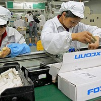 Taiwan's Foxconn to slash costs, layoff staff in 2019: report
