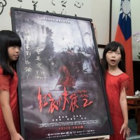 Photo of the day: Little girls in red haunt Presidential Office