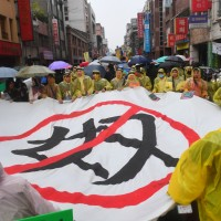 Activists protest exclusion of foreign workers from Taiwan's minimum wage laws
