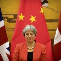 梅伊是否將與習進平談論香港政治與人權問題,引發外界關注。 (美聯社)