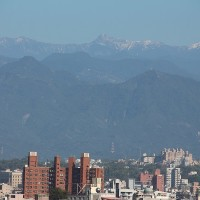 Residents of central Taiwan enthralled by rare view of snow-capped mountain