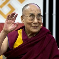 Dalai Lama's health improves after being hospitalized for chest infection