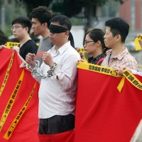 李明哲被捕一週年 陸委會籲中國盡快釋放
