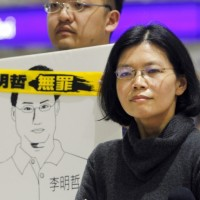 Taiwan activist's wife vows to keep fighting for his release