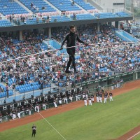 Acrobat throws first pitch mid-air at Taiwan baseball game