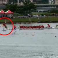 Video shows dragon boat head snap off, flag catcher dunked into drink