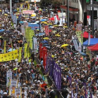 Photo story: tens of thousands march against China in Hong Kong