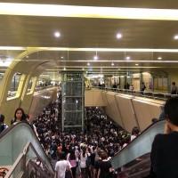 Typhoon holiday timing causes havoc on Taipei MRT