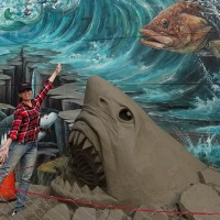 Sand sculpture displayin a community with 3D wall murals in SW Taiwan attracts visitors