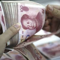 Investigators find 270 million yuan in cash at homes of Chinese financier