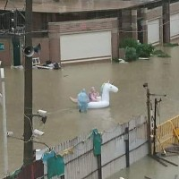 Photo of the Day: Unicorn floats on flooded Kaohsiung street